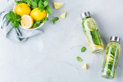 Health care, fitness, healthy nutrition diet concept. Fresh cool lemon cucumber mint infused water, cocktail, detox drink, lemonade in a glass jar. Light copy space top view flat lay background