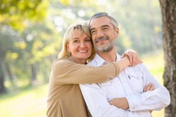 Health care happy senior lifestyle concept : Portrait photo of old happy senior caucasian couple smiling and relaxing in outdoor park on sunny day, hoot senior couple relax in spring or summer time.