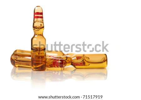 health care / medical concept: isolated set of ampules in white background with reflection