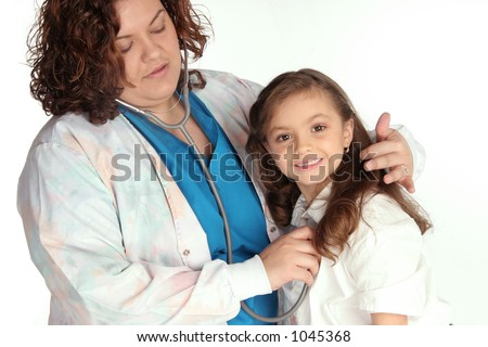 health care professional listens to young girls heart threw her stethoscope - stock photo