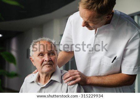 Health-care worker interested in health elderly man