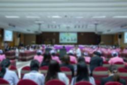 Health care worker meeting in meetingroom, blured background.