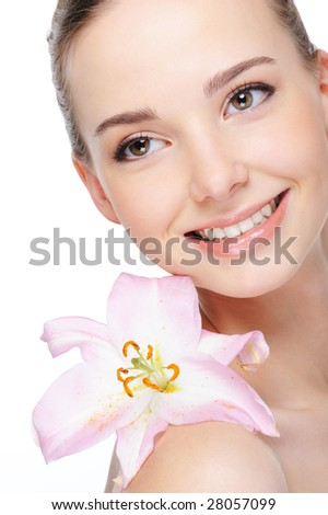 health complexion of beautiful happy laughing young woman with lily on her nude shoulder