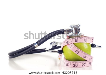 Health Concept - Weight Loss Green Apple, Measure Tape, and Stethoscope - Isolated over a  white background