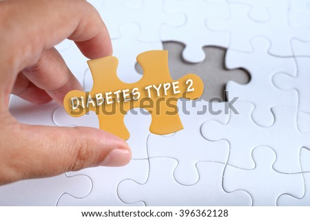 Health conceptual, hand holding puzzle written DIABETES TYPE 2 #396362128