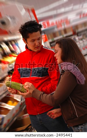 Health conscious shoppers discuss the virtues of asparagus.