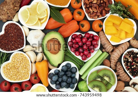 Health food for fitness concept with fruit, vegetables, pulses, herbs, spices, nuts, grains and pulses. High in anthocyanins, antioxidants, smart carbohydrates, omega 3,  minerals and vitamins.