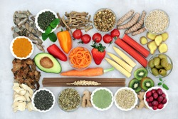 Health food & herbs used in natural & chinese herbal medicine to treat irritable bowel syndrome. High in antioxidants, protein, dietary fibre, vitamins, minerals, smart carbs & anthocyanins. Flat lay.