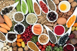 Health food to improve brain cognitive functions. Super foods concept very high in minerals, vitamins, antioxidants, omega 3 and anthocyanins. Top view.