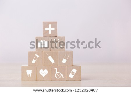 Health Insurance Concept,hand arranging wood block stacking with icon healthcare medical. #1232028409