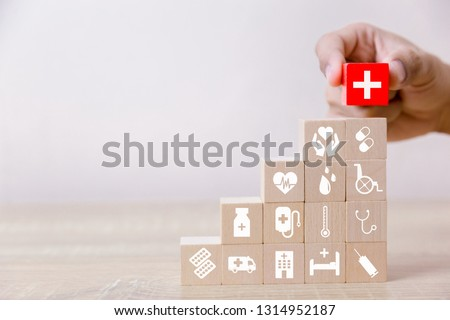 Health Insurance Concept,hand arranging wood block stacking with icon healthcare medical,for health. #1314952187