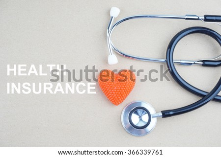 HEALTH INSURANCE concept with stethoscope and heart shape