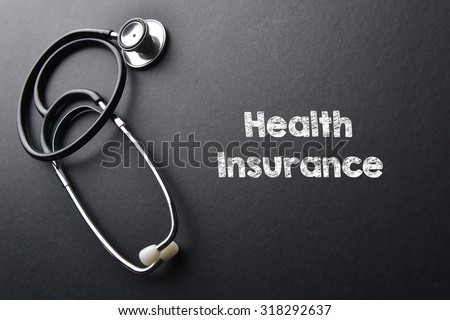Health insurance word with stethoscope - health concept. Medical conceptual