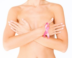 health, medicine, beauty concept - naked woman with breast cancer awareness ribbon