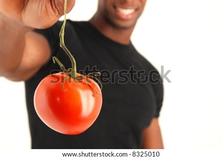 Health model holding a tomato