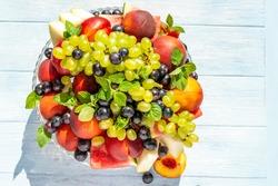 health plate, fruit plate grapes, melon, mint, banana, peaches, nectarines, watermelon