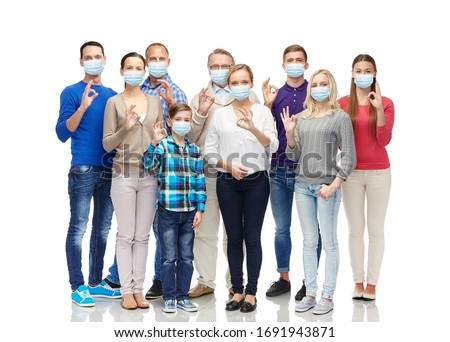 health, quarantine and pandemic concept - group of people wearing protective medical masks for protection from virus showing ok hand sign