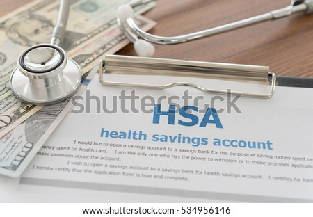 health savings account HSA concept with application form,dollar money, stethoscope on desk. #534956146