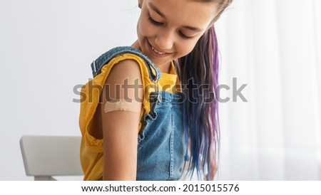 Healthcare And Inoculation Concept. Portrait Of Smiling Teen Patient Showing Vaccinated Arm With Plaster On Shoulder After Coronavirus Vaccination, Looking At Hand. Antiviral Vaccine, Banner, Panorama