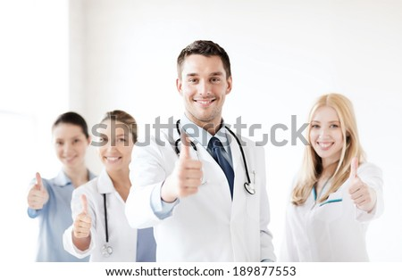 healthcare and medical professional young team or group of doctors showing thumbs up