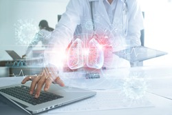 Healthcare and medicine, Covid-19, Doctor use laptop and diagnose virtual Human Lungs with coronavirus spread inside on modern interface on laboratory background, Innovation and Medical technology.