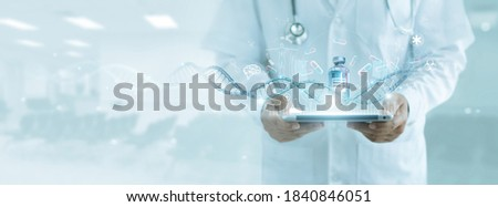 Healthcare and medicine, Doctor analyzing covid-19 coronavirus vaccine, Research and development successful develop vaccine and medicine for covid-19 pandemic. Electronic medical record on interface.