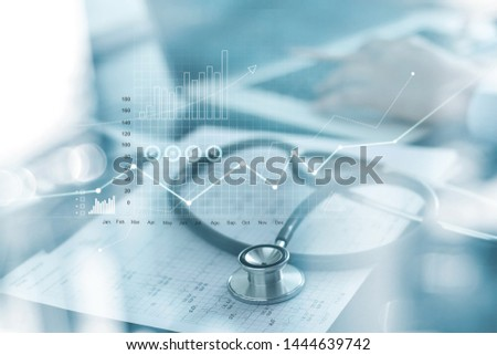 Healthcare business graph and Medical examination and businessman analyzing data and growth chart on blurred background