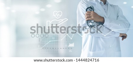 Healthcare business graph and Medical examination, Health Insurance, Doctor with stethoscope in hand and data growth chart ,Medical and medicine business on hospital background.