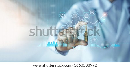 Healthcare business graph data and growth, Medicine industrial, Doctor holding drug analysis and examination on hospital background, Industry pharmacy.