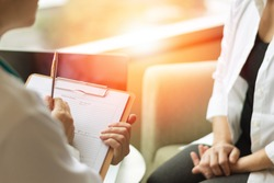 Healthcare concept of professional psychologist doctor consult in psychotherapy session or counsel diagnosis health. Major depressive disorder patient (MDD) with physician.