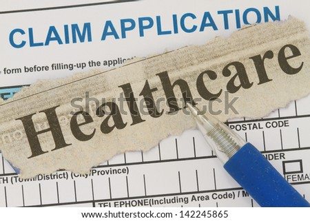 Healthcare newspaper cutout with blank worker's claim form.