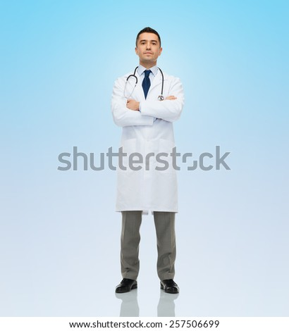 healthcare, profession, people and medicine concept - male doctor in white coat stethoscope over blue background