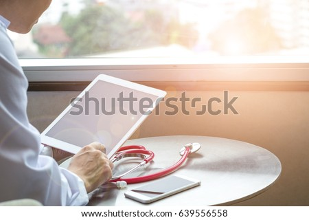 Healthcare professional medical doctor using tablet and smartphone for consult patient via online: Physician working tele-consultation: Hospital e-healthcare professionalism concept