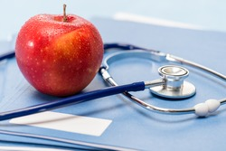 Healthcare red apple and medical stethoscope healthy lifestyle