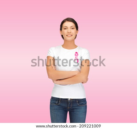 healthcare support people and medicine concept smiling woman in blank white t-shirt with breast cancer awareness ribbon over pink background