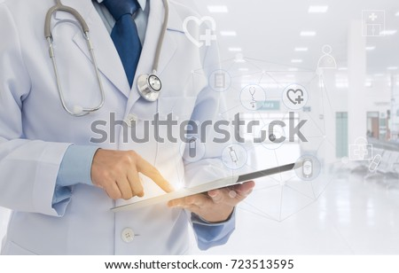 healthcare technology and medical concept. doctor using digital tablet with screen interface.