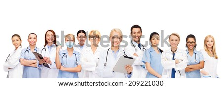 healthcare technology and medicine concept smiling female and male doctors and nurses with tablet pc computer