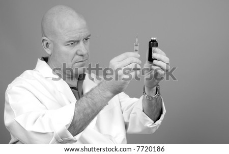 Healthcare Worker Holding Syringe and Medicine Preparing for Injection