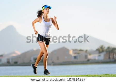 Healthy active female runner training outdoors for marathon. fitness woman lifestyle