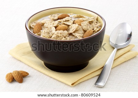 healthy almonds and riceflakes cereal with milk, part of a healthy nutrition program
