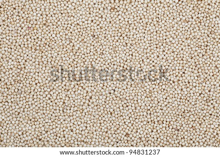 Healthy amaranth grain, a staple food of the Aztecs and becoming popular as a health food.  Presented full frame as a texture or background.