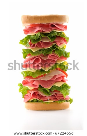 Healthy and big ham sandwich with lettuce, tomato and cheese isolated on white background.
