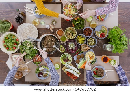 Healthy and colorful diet meal with friends, top view