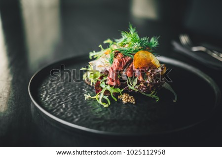 Healthy and delicious beef sandwich on dark table at restaurant, chef making food  #1025112958