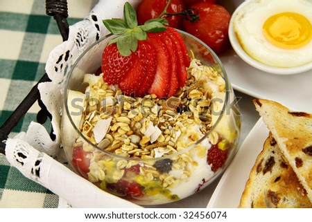 Healthy and hearty breakfast of muesli, strawberries and eggs.