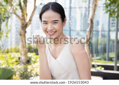Healthy and strong asian woman getting inoculated or vaccinated immunity by vaccine program, concept of recommended inoculation, vaccination roll-out, vaccine volunteer or vaccinated community people