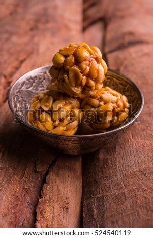 Healthy and sweet groundnut or peanut and Jaggery Laddoo, served in a bowl or plate. selective focus
