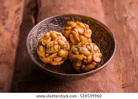 Healthy and sweet groundnut or peanut and Jaggery Laddoo, served in a bowl. selective focus