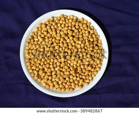 Healthy and tasty roasted chick peas snack with different spices #389482867