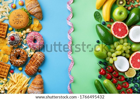 Healthy and unhealthy food background from fruits and vegetables vs fast food, sweets and pastry top view. Diet and detox against calorie and overweight lifestyle concept. Stock photo ©